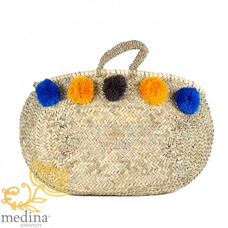 Moroccan basket with thin braided rope handles and pom poms blue orange and black