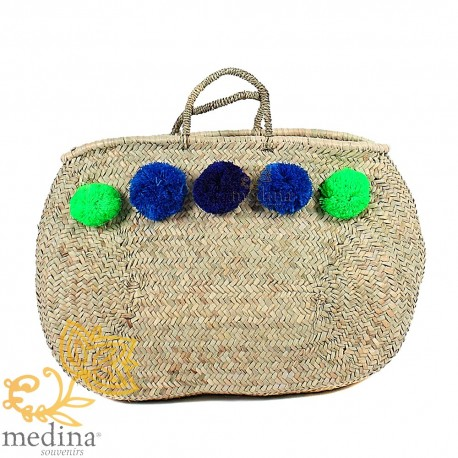 Moroccan basket with thin braided rope handles and PomPoms green blue and black