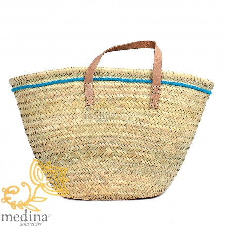 Moroccan basket with flat handles in natural leather and blue edging on the side