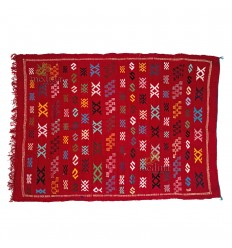 Hand made vintage carpet Berber carpet to the ethnic patterns on red background
