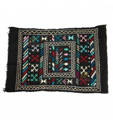 Hand made vintage carpet Berber carpet to ethnic patterns on black background